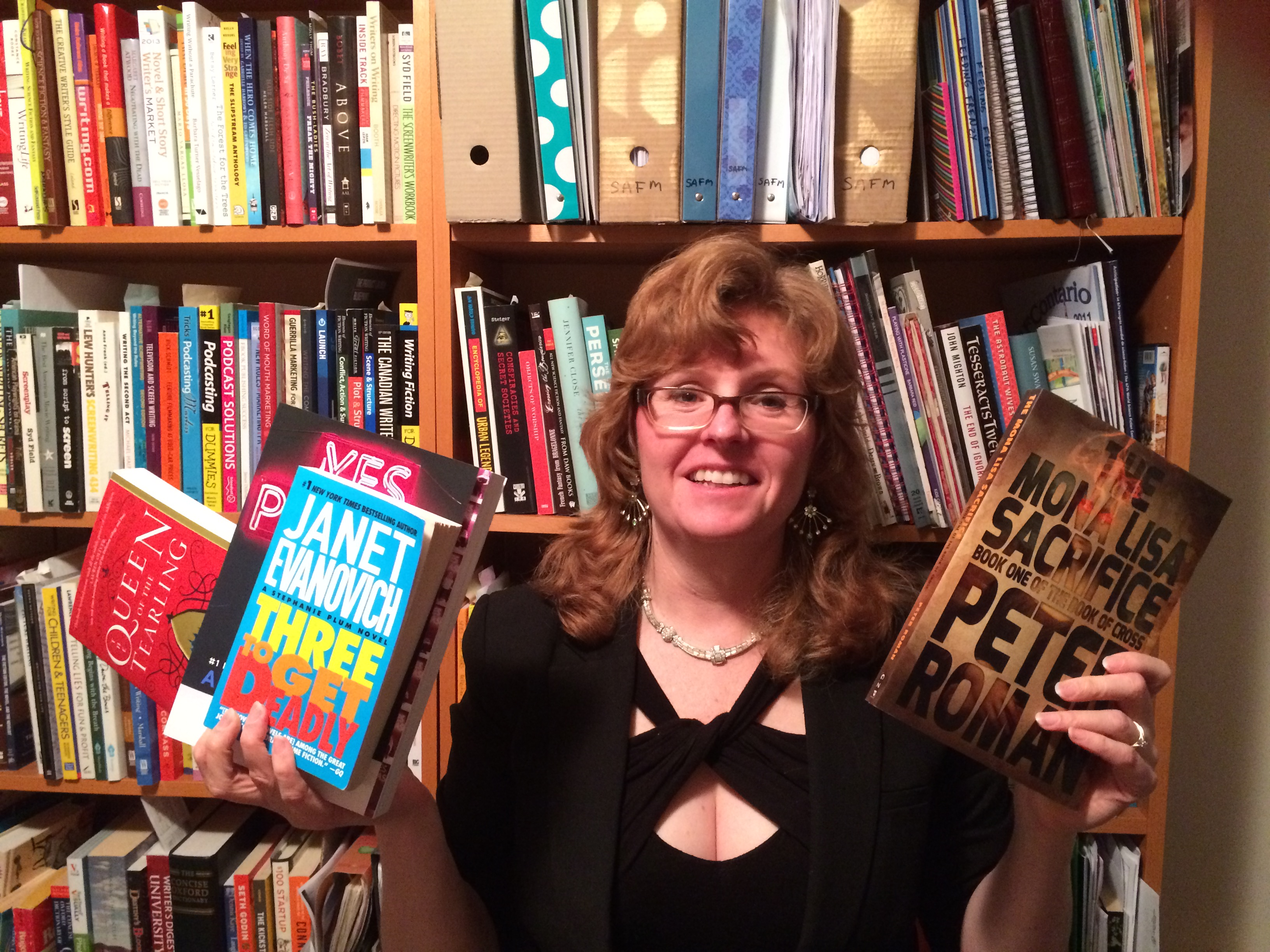 Maaja Wentz, posing with free book prizes for the Bookapalooza book fair